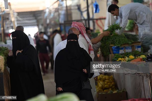 Saudi women do some shopping at Otaiga public market in the Manfouha district of the capital Riyadh on June 17 2015 as the faithful prepare for the...