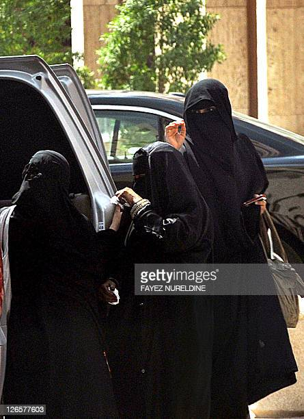 Saudi women exit a car in Riyadh on September 26 2011 a day after King Abdullah granted women the right to vote and run in municipal elections in a...
