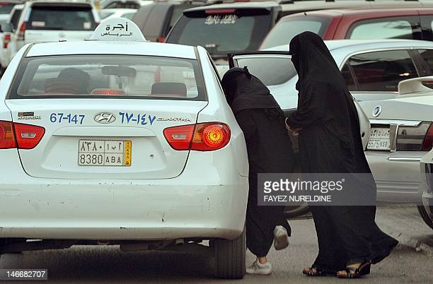 Saudi women get into a taxi outside a shopping mall in Riyadh on June 22 2012 Saudi female activists have cancelled their plan to brave a driving ban...
