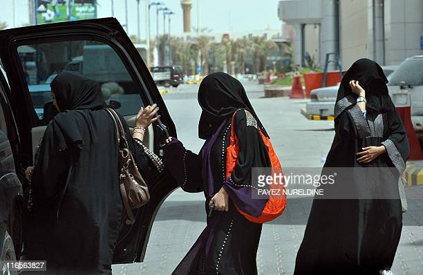 Saudi women get into the backseat of a car in Riyadh on June 14 three days before a June 17 nationwide campaign by Saudi women who are planning to...