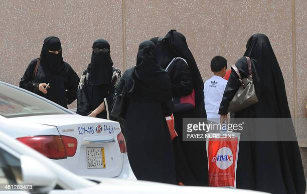 Saudi women leave a mall in the capital Riyadh on March 29 2014 Saudi activists have urged women to defy a traditional driving ban and get behind the...