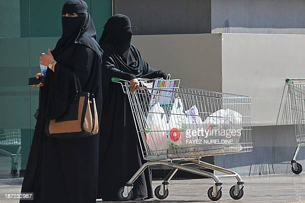 Saudi women leave a shoopping mall on November 7 2013 Saudi Arabia has the Arab world's largest economy but the unemployment rate among natives is...