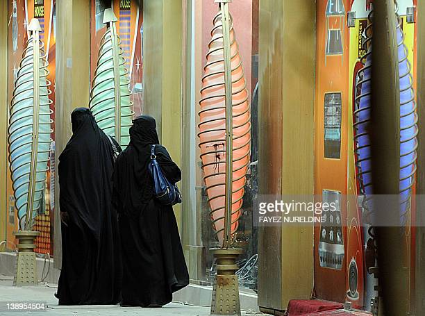 Saudi women stand outside a gift shop on February 14 2012 in the capital Riyadh where open celebration of Valentine's Day is officially banned along...