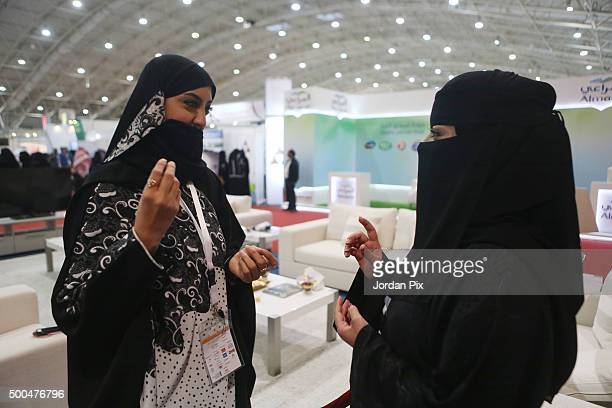 Saudi women talk during the first annual Bab Rizq Jameel a threeday job opportunity fair for Saudi youth where candidates are interviewed by...