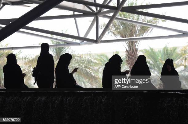 Saudi women wait for their drivers outside a hotel in the Saudi capital Riyadh on September 28 2017 Saudi Arabia will allow women to drive from June...