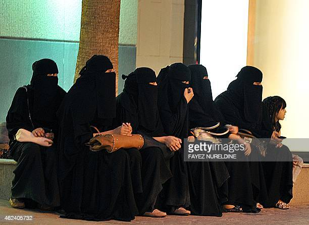 Saudi women wait for their drivers outside a shopping mall in Riyadh on September 26 2011 a day after King Abdullah granted women the right to vote...
