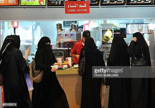 Saudi women wait in line in the 'women section' at of a fast food resturant in the 'Faysalia' mall in Riyadh City on September 26 a day after Saudi...
