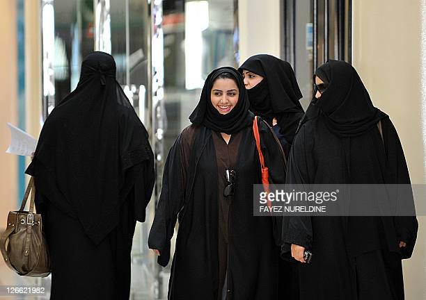 Saudi women walk inside the 'Faysalia' mall in Riyadh City on September 26 a day after Saudi Arabia's King Abdullah bin Abdulaziz alSaud granted...