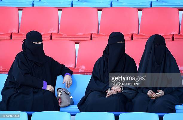 Saudi women watch a horse race at the King Abdulaziz Racetrack in the capital Riyadh on November 11 2016 The modern facility surrounded by greenery...