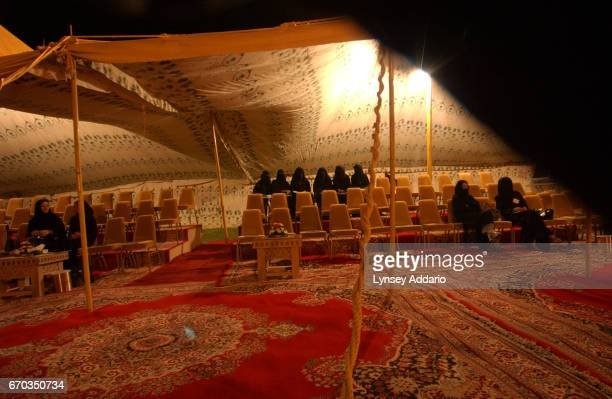 Saudi women watch a traditional Saudi performance at Al Aldria castle outside Riyadh during a celebration for the Human rights conference in Saudi...