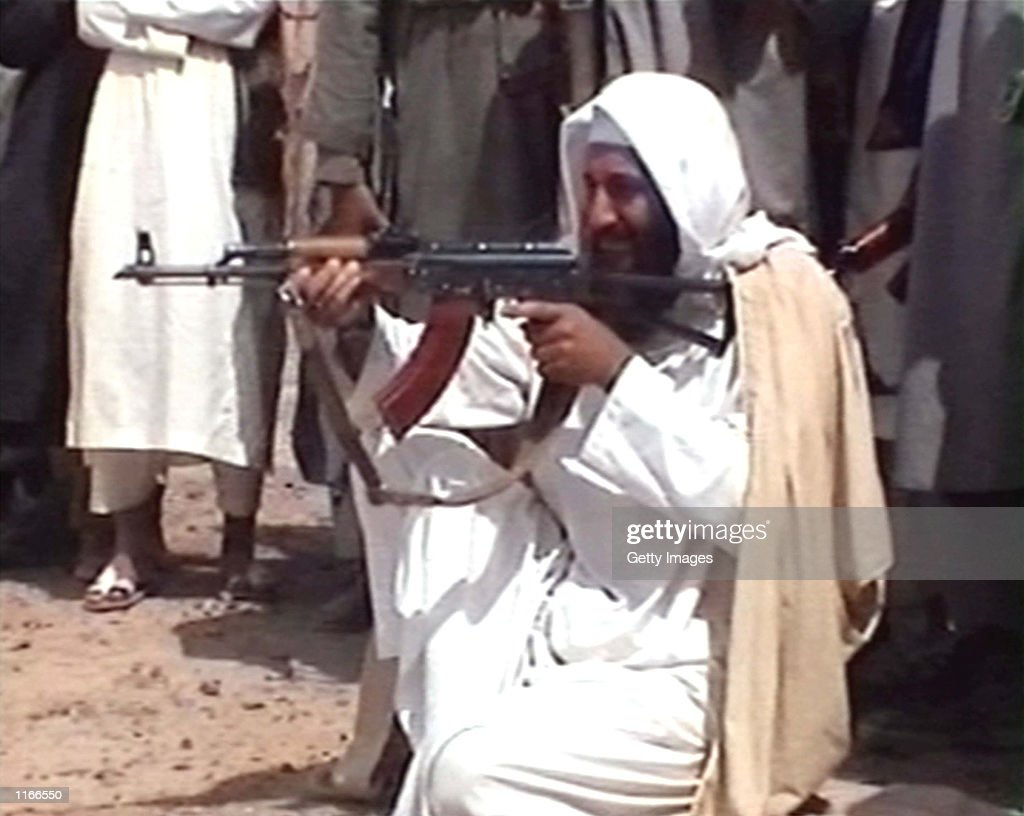 Saudiborn terrorist suspect Osama bin Laden is seen aiming a weapon in this undated photo from AlJazeera TV