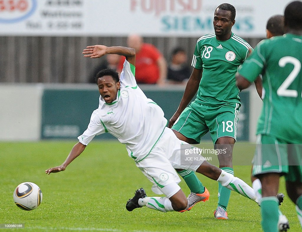 Saudi's Abdullah Jaman Shuhail (L) falls down as Nigeria's Victor Obinna looks on during their friendly match between Saudi Arabia and Nigeria in Alpen stadium in Tyrolian Wattens on May 25, 2010 prior to the FIFA World Cup 2010 hosted by South Africa.i