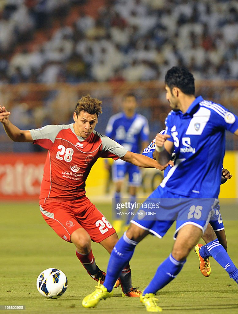 Saudi's Al Hilal player Almarshadi (R) fights for the ball with Qatar's Lekhwiya Youssef Msakni (L) during their AFC Champions League football match on May 15, 2013 at the Prince Faisal bin Fahad stadium in Riyadh.