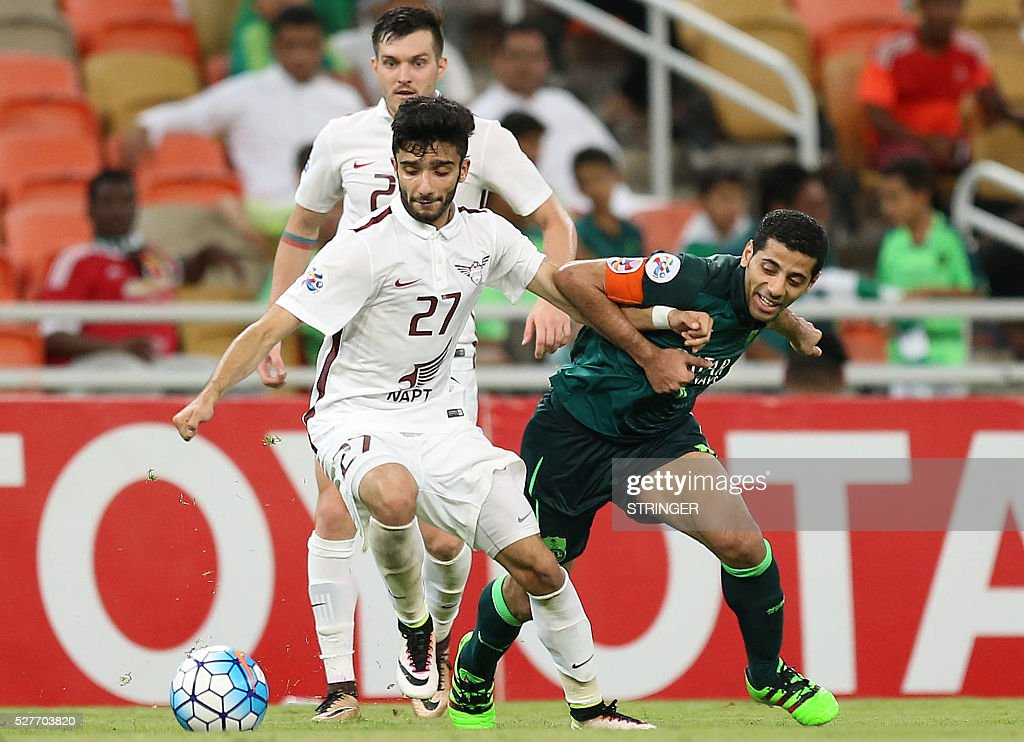 Saudi's Al-Ahli captain Tasir Al-Jassim defends as Qatar's El-Jaish player Amhad Moein Doozandeh dribbles the ball during their AFC Champions League group D football match at the King Abdullah Spots City in Jeddah on May 3, 2016. / AFP / STRINGER