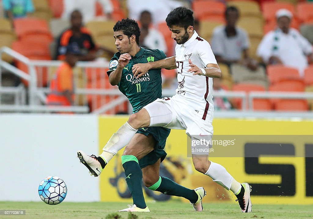 Saudi's Al-Ahli player Hussain al-Mogahwi (back) and Qatar's El-Jaish player Amhad Moein Doozandeh vie for the ball during their AFC Champions League group D football match at the King Abdullah Spots City in Jeddah on May 3, 2016. / AFP / STRINGER