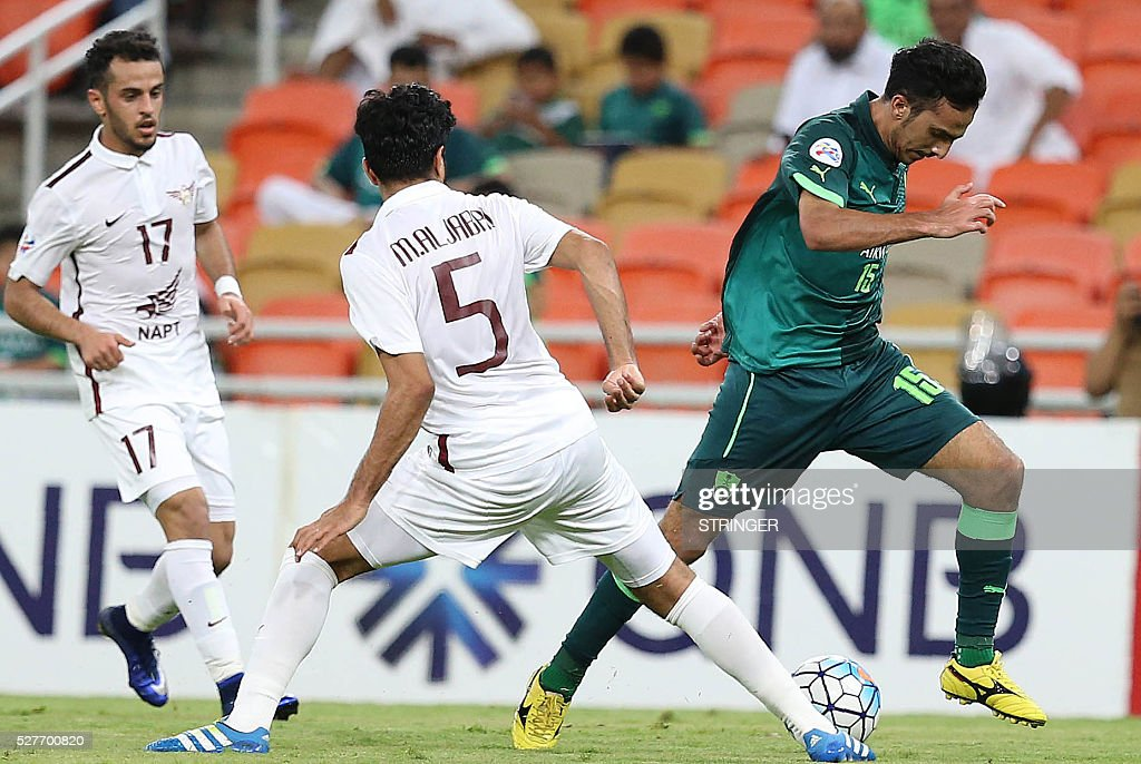 Saudi's Al-Ahli player Saleh Al-Jamaan (R) dribbles the ball past Qatar's El-Jaish player Mohammed Al-Jabri (C) and Othman al-Yahri during their AFC Champions League group D football match at the King Abdullah Spots City in Jeddah on May 3, 2016. / AFP / STRINGER