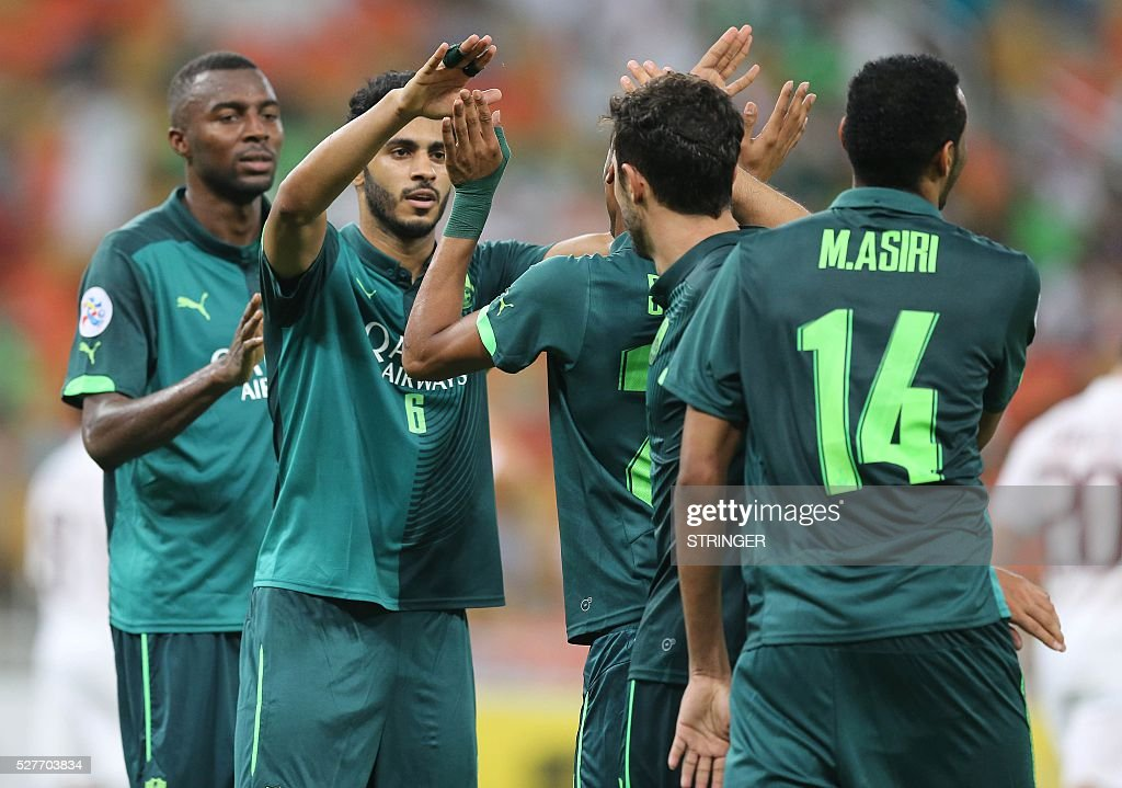 Saudi's Al-Ahli players celebrate after scoring a goal during their AFC Champions League group D football match against Qatar's El-Jaish club at the King Abdullah Spots City in Jeddah on May 3, 2016. / AFP / STRINGER