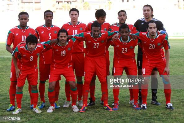 Saudi's alEttifaq players pose for a team photo prior to their match against Lebanon's alAhed in their Group C AFC Cup football match at the Sidon...