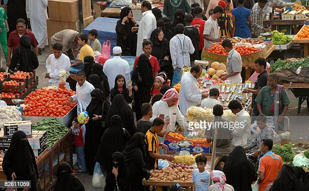 Saudis clog a market in the Red Sea city of Jeddah as they rush to buy vegetables and fruits on August 31 2008 one day before the start of the holy...
