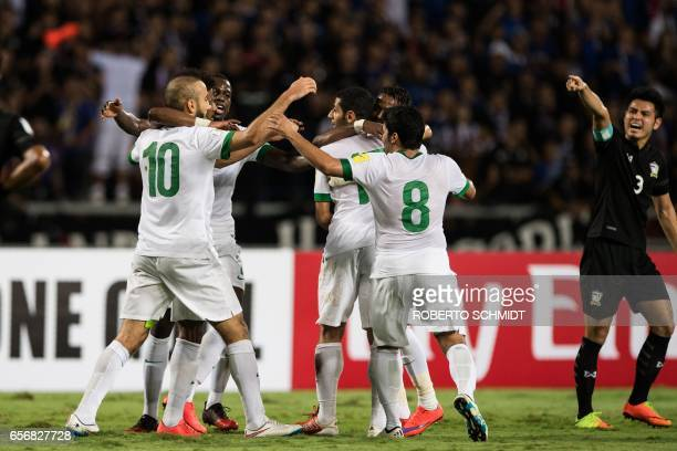 Saudi's Mohammed Al Sahlawi celebrates with teammates following his goal in the first half during the Round 3 Group B 2018 World Cup football...