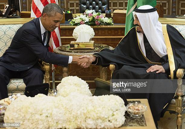 Saudi's newly appointed King Salman shakes hands with US President Barack Obama at Erga Palace in Riyadh on January 27 2015 Obama landed in Saudi...