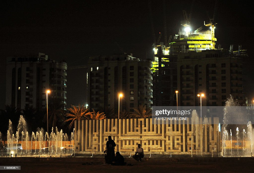 Saudis sit in a square in the Andalus main coastal street of the Red Sea port city of Jeddah early on July 9 2011 AFP PHOTO/FAYEZ NURELDINE