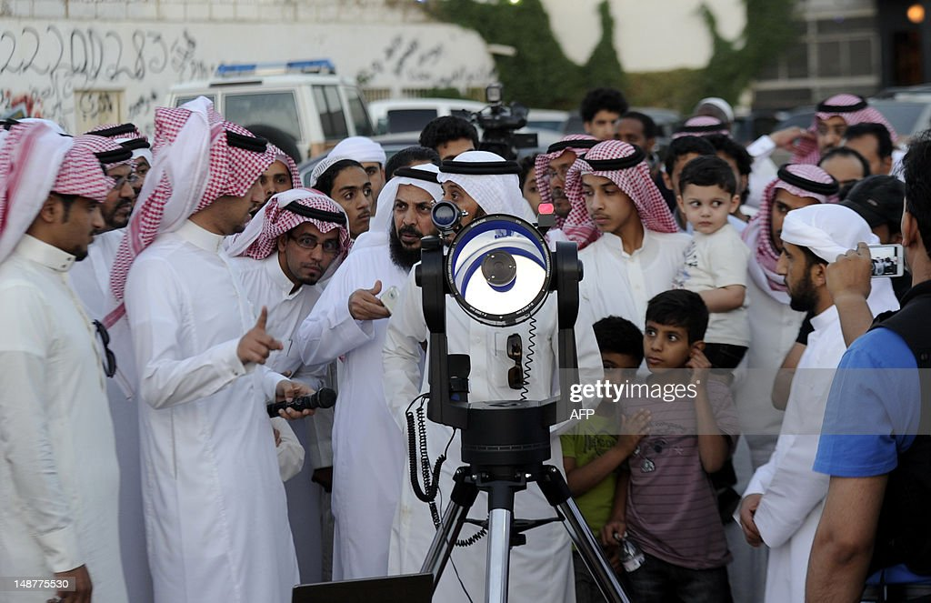 Saudis use a telescope to monitor the new moon of Ramadan as astronomers and scholars of Islam debate when the holy Muslim month of Ramadan begins, in the Saudi city of Taif on July 19, 2012. The start of the fasting month, when the faithful abstain from eating from dawn to sunset, is determined by the sighting of the new moon.
