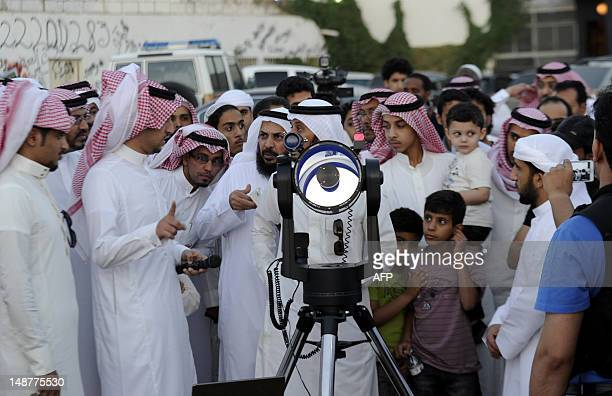 Saudis use a telescope to monitor the new moon of Ramadan as astronomers and scholars of Islam debate when the holy Muslim month of Ramadan begins in...