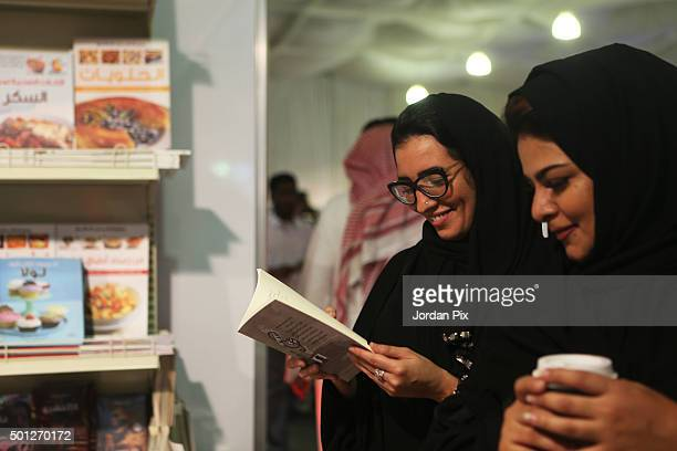 Saudis visit the Jeddah International Book Fair that opened on Friday and lasts for a month on Sunday December 13 2015 in Jeddah Saudi Arabia