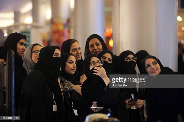 Saudis women take a selfie picture at a Mall on December 10 2015 in Jeddah Saudi Arabia