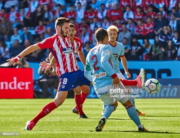 Saul Ñiguez of Atletico de Madrid competes for the ball with Hugo Mallo of Celta de Vigo during the La Liga match between Celta de Vigo and Atletico...