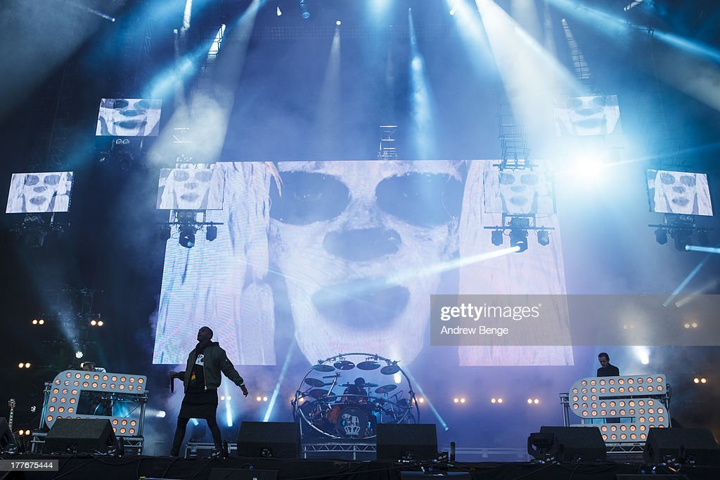 Saul Milton, MC Rage and Will Kennard of Chase and Status perform on stage on Day 3 of Leeds Festival 2013 at Bramham Park on August 25, 2013 in Leeds, England.