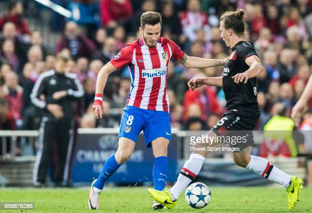Saul Niguez Esclapez of Atletico de Madrid competes for the ball with Julian Baumgartlinger of Bayer 04 Leverkusen during their 201617 UEFA Champions...