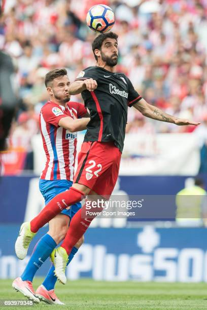 Saul Niguez Esclapez of Atletico de Madrid fights for the ball with Raul Garcia of Athletic Club during the La Liga match between Atletico de Madrid...