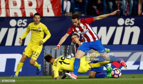 Saul Niguez Filipe Luis of Atletico Madrid and Samu Castillejo of Villarreal battle for the ball during the La Liga match between Club Atletico de...