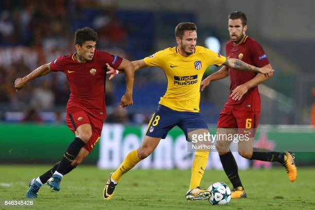 Saul Niguez of Atletico between Diego Perotti of Roma and Kevin Strootman of Roma during the UEFA Champions League Group C football match between AS...