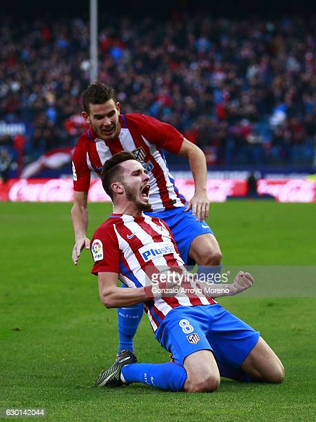 Saul Niguez of Atletico de Madrid celebrates scoring their opening goal with teammate Lucas Hernandez during the La Liga match between Club Atletico...