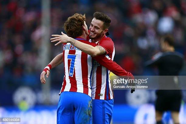 Saul Niguez of Atletico de Madrid celebrates scoring their opening goal with teammate Antoine Griezmann during the La Liga match between Club...