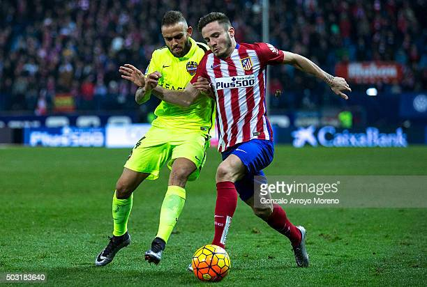 Saul Niguez of Atletico de Madrid competes for the ball with David Navarro of Levante UD during the La Liga match between Club Atletico de Madrid and...