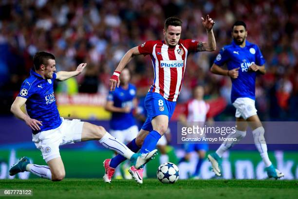 Saul Niguez of Atletico de Madrid competes for the ball with Jamie Vardy of Leicester City FC during the UEFA Champions League Quarter Final first...