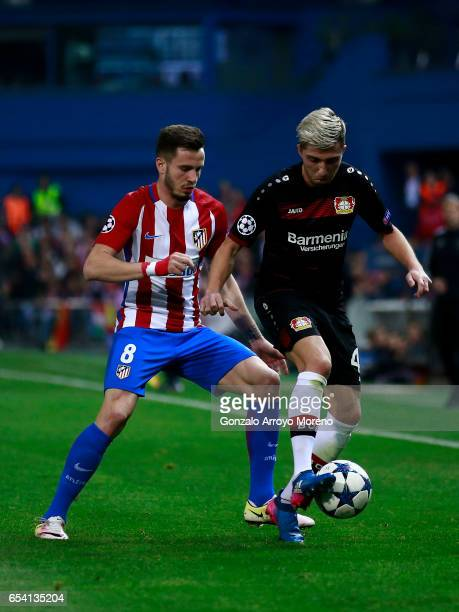 Saul Niguez of Atletico de Madrid competes for the ball with Kevin Kampl of Bayer Leverkusen during the UEFA Champions League Round of 16 second leg...