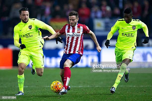 Saul Niguez of Atletico de Madrid competes for the ball with Nabil Ghilas of Levante UD and his teammate Jefferson Lerma during the La Liga match...