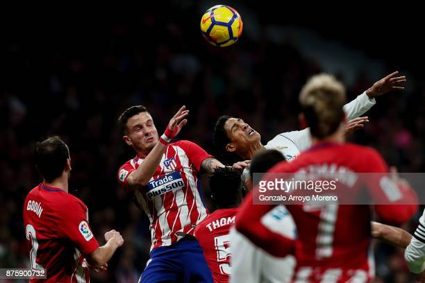 Saul Niguez of Atletico de Madrid competes for the ball with Raphael Varane of Real Madrid CF during the La Liga match between Club Atletico Madrid...