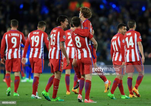Saul Niguez of Atletico Madrid and Antoine Griezmann of Atletico Madrid celebrate their win with their Atletico Madrid team mates after the UEFA...