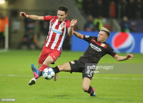 Saul Niguez of Atletico Madrid and Kevin Kampl of Bayer Leverkusen battle for the ball during the UEFA Champions League Round of 16 first leg match...