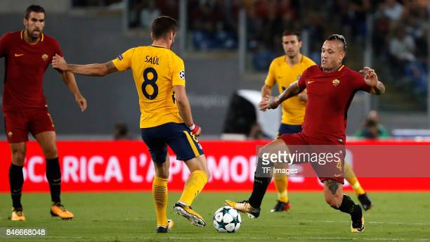 Saul Niguez of Atletico Madrid and Radja Nainggolan of Rom battle for the ball during the UEFA Champions League group C match between AS Roma and...