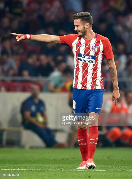 Saul Niguez of Atletico Madrid celebrates after scoring the first goal during the La Liga match between Atletico Madrid and Barcelona at Estadio...