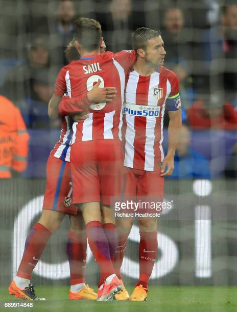 Saul Niguez of Atletico Madrid celebrates scoring his sides first goal with his Atletico Madrid team mates during the UEFA Champions League Quarter...