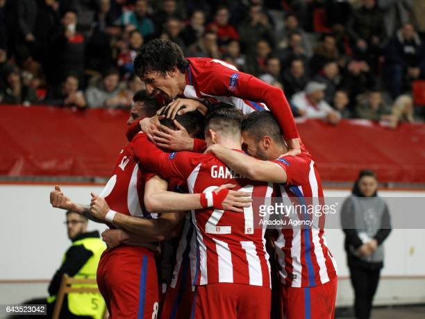 Saul Niguez of Atletico Madrid celebrates with his teammates after scoring a goal during the UEFA Champions League round of sixteen soccer match...