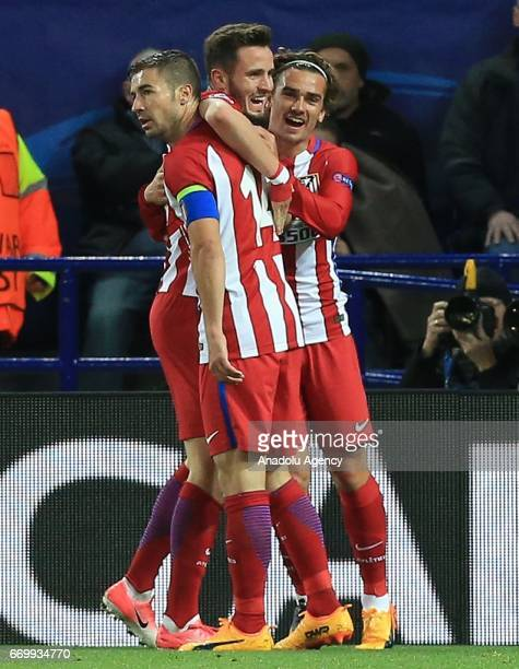 Saul Niguez of Atletico Madrid celebrates with his teammates after scoring during Champions League Quarter Final second leg soccer match between...